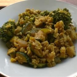 Kickin' Chicken Stir Fry Recipe - This kickin' chicken stir fry is spiked with flavor and colorful vegetables. It is served over chili flavored rice, so you are sure to have a spicy bite every time.