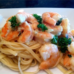 Shrimp Scampi Bake Recipe - This rendition of a classic dish of shrimp baked in butter, garlic, lemon juice and parsley, is even better with the help of Dijon-style mustard.