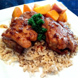 Grilled Chicken Adobo Recipe - Dark chicken thigh meat is cooked in a rich soy sauce, garlic, and vinegar mixture, then tossed on the grill until crisp. Serve over rice.