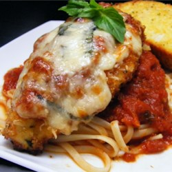 Simple Chicken Parmesan Recipe - Simple Chicken Parmesan is the perfect dish to lure kids into the kitchen - what kid doesn't like chicken tenders and spaghetti? And this dish is loaded with mini cooking lessons. With one simple recipe, kids learn how to boil pasta, mince garlic, grate cheese, make tomato sauce, and pound, bread and saute cutlets. Bonus: This recipe makes twice the sauce needed, so freeze half for another meal.
