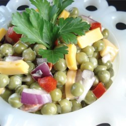 Mom's Easy Pea Salad Recipe - Peas, American cheese, and pimentos are folded into salad dressing and served chilled in this easy, old-fashioned pea salad.