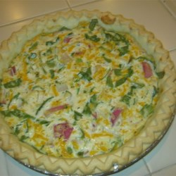 Eggless Tofu Spinach Quiche Recipe - Tofu and milk are blended, then baked with spinach, garlic, onion, Cheddar and Swiss cheeses. Soy milk and cheeses may be substituted to make a veggie quiche.