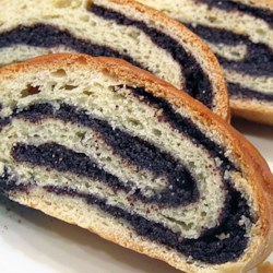 Old World Poppy Seed Roll Recipe - Homemade poppy seed filling is rolled up inside a buttery yeast dough and baked until golden brown. The recipe yields 2 filled loaves.