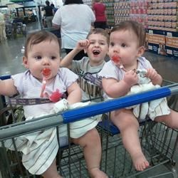 Their first time sitting in a shopping cart...They LOVED it! :)