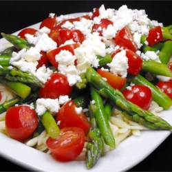 Asparagus, Feta and Couscous Salad Recipe - This fresh and simple salad featuring asparagus, tomatoes, and feta is lovely as a complement to a main course or on its own.