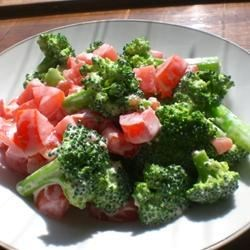 Blue Cheese Broccoli Salad Recipe - I tried this wonderful salad combination of blue cheese dressing, broccoli, and tomatoes. A great side dish and wonderful summer salad.