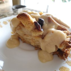 Best Bread Pudding with Vanilla Sauce Recipe and Video - A beloved recipe for bread pudding, rich with milk and eggs, and chock-full of raisins, was found tucked away in a family Bible for safekeeping. It has a smooth vanilla sauce for serving warm over the pudding, too.