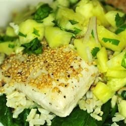 Sweet Sesame Mahi Mahi Recipe - Mahi mahi fillets are coated with sesame seeds before being pan-fried in this recipe, which also makes a simple pineapple salsa for serving with the cooked fish.