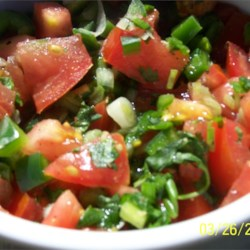 Spicy Salsa Recipe - Four jalapeno peppers are diced and mixed into this very tomato salsa, so it 's quite nippy. And there 's a bit of garlic and cilantro to help it along as well. It 's finished with a splash of lime juice and chilled until ready to serve. Makes three cups.