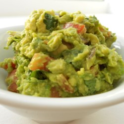 Guacamole Recipe - Cilantro and cayenne give this classic guacamole a tasty kick. Serve it smooth or chunky.
