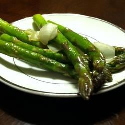 Pan-Fried Asparagus with Onions Recipe - Asparagus pan-fried in butter with onions is the perfect accompaniment to your main course.