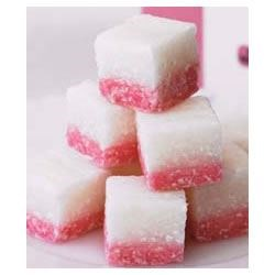 Coconut Ice Recipe - A festive coconut candy with two colors. A chewy and delicious treat.