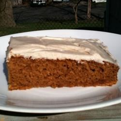 Pumpkin Bars I Recipe - This spiced pumpkin-nut snack cake is delicious topped with cream cheese frosting. It makes two 9x13-inch pans.