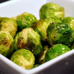 Roasted Brussels Sprouts Recipe - Brussels sprouts are simply seasoned with salt, pepper, and olive oil, then slow-roasted in a very hot oven until darkest brown. They are the perfect combination of sweet and salty, and make for perfect snack leftovers straight from the fridge the next day!