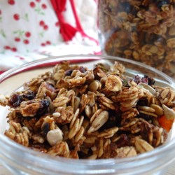 Crunchy and Delicious Granola Recipe - Applesauce is used in this recipe instead of sugar for sweetening granola with dried cherries, pumpkin and sunflower seeds and wheat germ.
