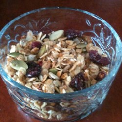 Nutty Granola Recipe - Dried fruit and honey give the sweet to this granola with almonds, oats, coconut, and pumpkin and sunflower seeds.