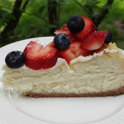 Meredith's Cheesecake Recipe - Eggs, cream cheese, sour cream, heavy cream, sugar and vanilla are blended and poured over a cinnamon graham cracker crust in this easy cheesecake serving 10 to 12.