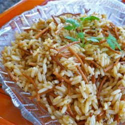 Ann's Rice Pilaf Recipe - Golden bits of vermicelli pasta add a toasted flavor to this quick pilaf. Use your favorite seasoning in place of Greek seasoning, if desired.