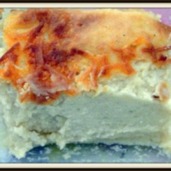 Mashed Potato Casserole Recipe - My mom gave me this recipe years ago. Every time I make it, people always request the recipe. It's really good and easy, made with instant potato mix and flavored with cream cheese and onion dip.