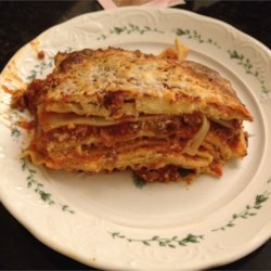 Classic Lasagna Recipe - Make this classic lasagna recipe zestier by using hot Italian sausage or a little milder with regular Italian sausage.  Don't be scared off by the long cooking time.  The wait is well worth it. It's a great dish to make for a crowd and easy to adjust for varying tastes.  The leftovers are even better when reheated the next day.