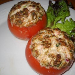 Tuna and Goat Cheese Stuffed Tomatoes Recipe - An excellent side dish or a light meal, these baked tomatoes are stuffed with a delicious mixture of goat and mascarpone cheeses, tuna, and sesame seeds, then are topped off with Parmesan cheese.