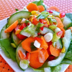 Cucumber-Carrot Salad Recipe - Seasoned rice vinegar and fresh ginger give this cucumber and carrot salad a bit of an Asian flair.