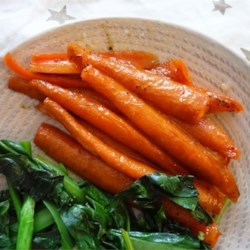 Honey Roasted Carrots Recipe - Carrots are tossed with olive oil and honey in this simple, easy, and delicious side dish.