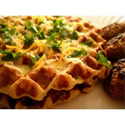 Potato Waffles Recipe and Video - These savory potato waffles are similar to potato pancakes, but in waffle form. The batter consists of onion, garlic, and mashed potatoes cooked until golden brown in your waffle iron. Serve with fish or chicken and sauteed apples.