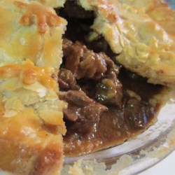Steak and Irish Stout Pie Recipe - This savory pie is filled with an Irish stout gravy, loaded with steak, and baked between two flaky pie crusts.
