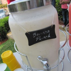 Snow Punch Recipe - Bananas, cream, lemon juice, citrus soda, sugar and lemon sherbet in a lemony creamy blend.