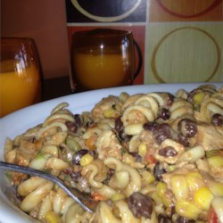 Barbeque Chicken Pasta Salad Recipe - Whole wheat shell pasta, jicama, corn, peppers, black beans, and chicken breast meat combine with tangy barbeque dressing for a big, colorful pasta salad.