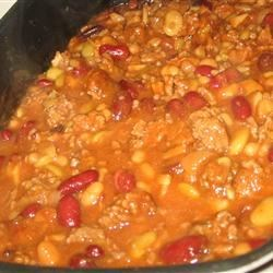 Calico Beans Recipe - These hearty beans full of ground beef and bacon are great for a picnic or potluck.
