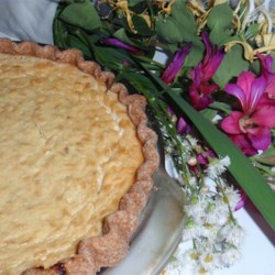Easter Rice Pie Recipe - These fresh-tasting pies have an eggy rice and pineapple filling in a single crust. They're baked until golden brown.