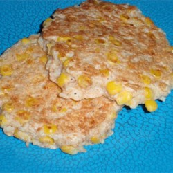 Brown Rice and Corn Cakes Recipe - These unique brown rice and corn cakes have a hint of chives and nutmeg for a flavorful side dish or special dinner.