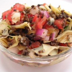 Artichoke Salsa Recipe - Artichoke hearts, with tomato, olives, onion, and basil, is a great new twist on 'salsa'.