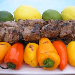 Margarita Beef Skewers Recipe - These skewers are quick and easy to make and taste terrific. With tender top sirloin, you don't need to marinate a long time to tenderize the meat, just long enough to impart the flavors of the citrus and garlic marinade. Serve over rice.