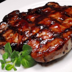 Grilled Pork Loin Chops Recipe - Boneless pork loin chops, marinated in a tangy sweet-and-savory marinade with a hint of spice, grill up all moist and browned for a delightful grilled supper for two.