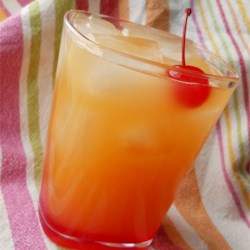 Pineapple Upside-Down Cake in a Glass Recipe - You'll be happy you sought and found cake-flavored vodka when enjoying this adult beverage with pineapple juice.