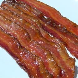 Candied Bacon Recipe - Smoky bacon is baked with a brown sugar and maple syrup glaze for a crunchy and sweet party snack.