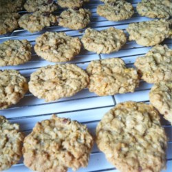 Mom's Ranger Cookies Recipe - Golden-brown cookies bake up with a crunchy and chewy texture thanks to coconut, rolled oats, and corn flakes.