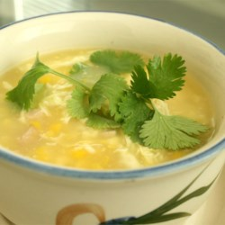 Velvety Chicken Corn Soup Recipe - Chicken broth and a can of cream of corn soup are combined with cooked chicken breast in this Chinese inspired soup flavored with sesame oil and thickened with corn starch and egg white.