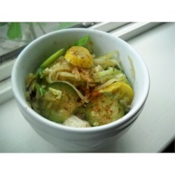 Yellow Squash and Zucchini Delight Recipe - Need a new way to cook all that summer squash?  This recipe combines zucchini, yellow squash, cabbage and onions, cooked in chicken broth.  Easy and delicious!