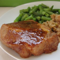 Marinated Baked Pork Chops Recipe and Video - Pork chops cook in a tangy marinade of soy sauce, Worcestershire, and ketchup-15-minute prep!