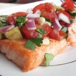 Chilled Salmon With Summer Tomato Salsa Recipe - Succulent salmon fillets are topped with a tantalizing salsa featuring avocado, tomato, and corn.