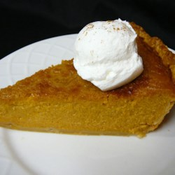Mrs. Sigg's Fresh Pumpkin Pie Recipe - A mixture of fresh pumpkin puree, brown sugar, spices, evaporated milk and eggs is poured into a prepared pie crust and baked.