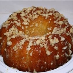 Coconut Pound Cake Recipe - Children of all ages (even the grown-up kind) will love this recipe for a buttery coconut-flavored pound cake with walnuts.
