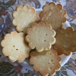 Rochelle Sable Recipe - The French word sables means 'sand cookies' or 'sandies,' so named  because of their fine, crumbly texture. The hard-cooked egg yolk adds extra richness to the orange-scented cookie.