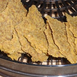 Cheezy Flax Crackers Recipe - Raw vegan crackers have a tangy flavor reminiscent of cheese from cashews, flaxseeds, red bell pepper, and lemon juice. The combination is dehydrated to make a crisp cracker.