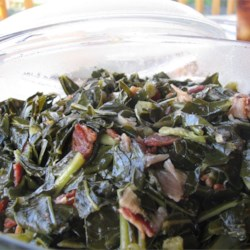 Kickin' Collard Greens Recipe - If you like greens you will love this recipe.  The bacon and onions give them a wonderful flavor.  Add more red pepper for a little more spice.