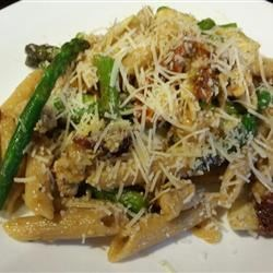 Chicken Penne with Asparagus, Sun-dried Tomatoes, and Artichoke Hearts Recipe - A light and fresh skillet supper of penne pasta, chicken, asparagus, artichoke hearts, and sun-dried tomato is a great way to celebrate asparagus season. Using pre-cooked chicken makes it easy to get on the table.